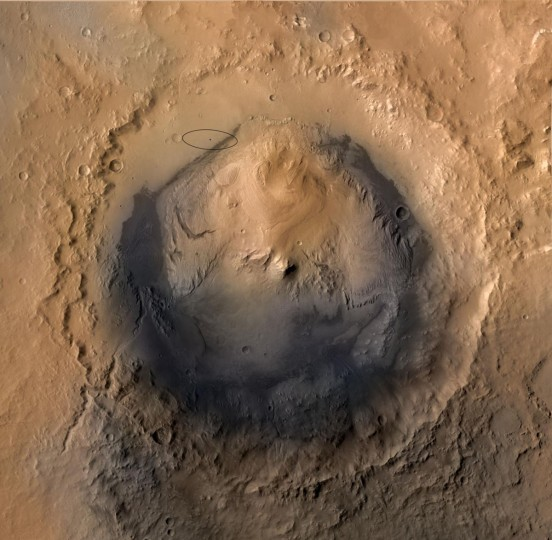 The target landing area for NASA's Mars Science Laboratory mission is the ellipse marked on this image of Gale Crater on Mars (top L). The ellipse is about 12 miles long and 4 miles wide (20 kilometers by 7 kilometers). his view of Gale Crater is derived from a combination of data from three Mars orbiters. The view is looking straight down on the crater from orbit. Gale Crater is 96 miles (154 kilometers) in diameter. (NASA/JPL-Caltech/ESA/DLR/FU Berlin/MSSS/Handout/Reuters)