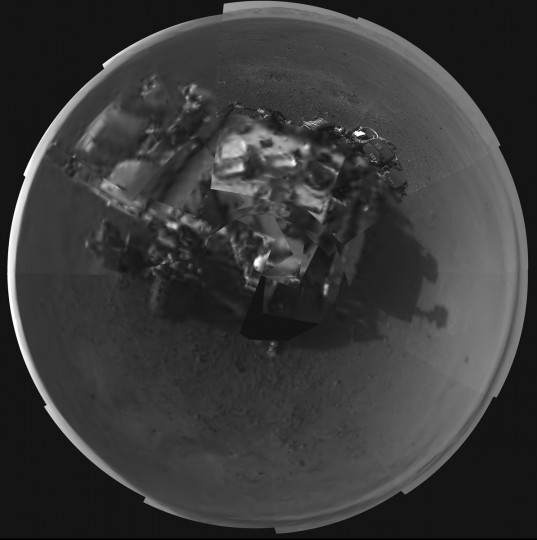 August 8, 2012: This Picasso-like self portrait of NASA's Curiosity rover was taken by its Navigation cameras, located on the now-upright mast. The camera snapped pictures 360-degrees around the rover, while pointing down at the rover deck, up and straight ahead. Those images are shown here in a polar projection. Most of the tiles are thumbnails, or small copies of the full-resolution images that have not been sent back to Earth yet. (NASA/JPL/Handout/Reuters)
