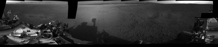 "(Click to ZOOM in. Then double-click to ZOOM and MOVE around the image.) August 9, 2012: This 360-degree, full-resolution panorama from NASA's Curiosity rover shows the area all around the rover within Gale Crater on Mars. The rover's deck is to the left and far right. The rover's ""head"" or mast, where the Navigation cameras that took this picture are located, casts a shadow seen near the center. The rim of Gale Crater is to the left, and the base of Mount Sharp is to the center-right. (NASA/JPL-Caltech/Handout/Reuters)"