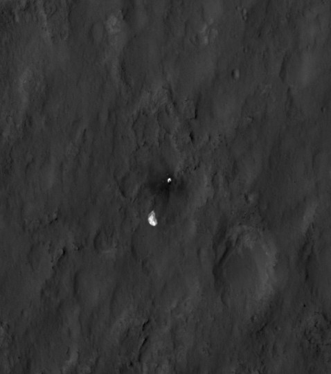 August 7, 2012: The parachute and back shell of NASA's Curiosity rover strewn across the surface of Mars, is seen in this close-up view released by NASA. The image was captured by the High-Resolution Imaging Science Experiment (HiRISE) camera on NASA's Mars Reconnaissance Orbiter about 24 hours after the parachute helped guide the rover to the surface. When the back shell impacted the ground, bright dust was kicked up, exposing darker material underneath. (NASA/JPL-Caltech/Univ. of Arizona/Handout/Reuters)