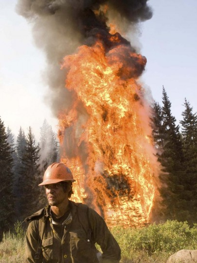 A U.S. Forest Service firefighter works on the Springs Fire in Boise National Forest near Banks-Garden Valley, Idaho (Kari Greer/US Forest Service)