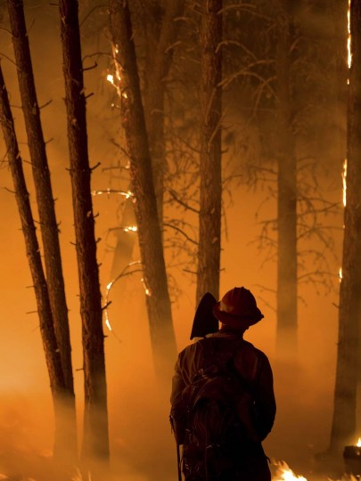 A firefighter watches a burn operation in Boise National Forest near the community of Featherville, Idaho. (Kari Greer/U.S. Forest Service)