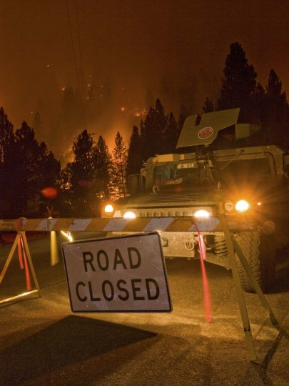 A National Guard vehicle is parked at a road closure close to a burn operation in Boise National Forest near the community of Featherville, Idaho. (Kari Greer/U.S. Forest Service)