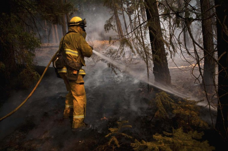 A firefighter battles the Chips fire near Greenville, California. The fire has forced evacuations and burned over 47,000 acres in Northern California. (Max Whittaker/Reuters photo)