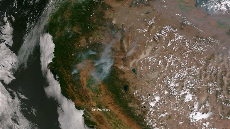 View from the Suomi NPP satellites shows smoke plumes from forest fires afflicting Northern California in this NOAA handout image dated August 20, 2012. (REUTERS/NOAA)/