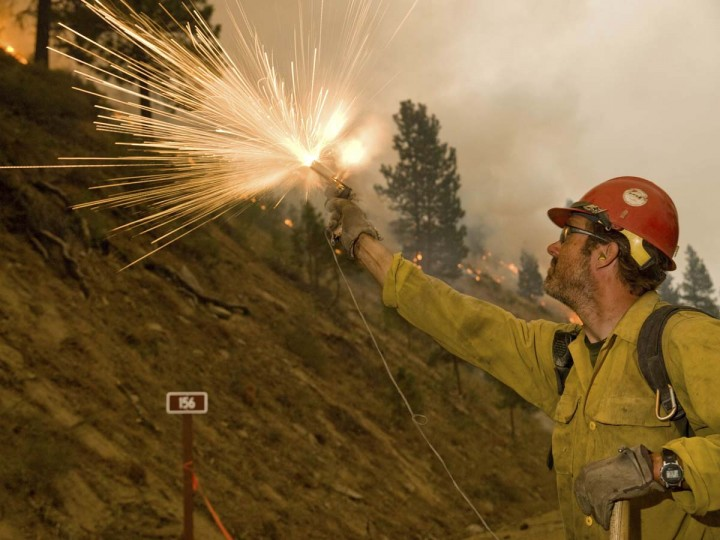 A firefighter ignites a burn operation in Boise National Forest near the community of Featherville, Idaho. The Idaho fire was one of dozens burning across 10 parched western states, with Nevada, Idaho, and California each seeing hundreds of thousands of acres charred. (Kari Greer/U.S. Forest Service)