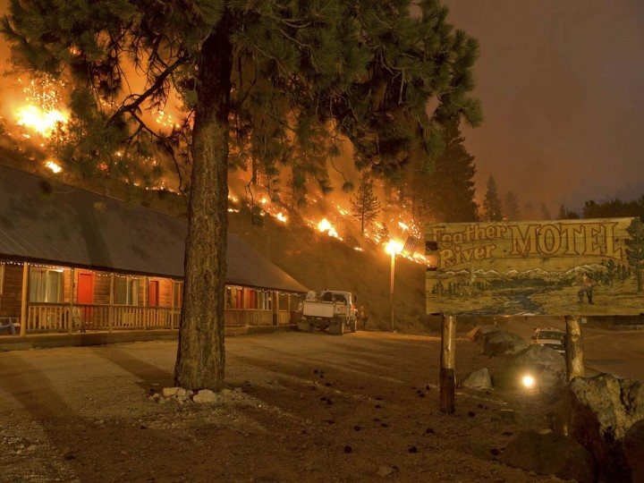A forest burns next to the Feather River Motel in Boise National Forest in the community of Featherville, Idaho. (Kari Greer/U.S. Forest Service)