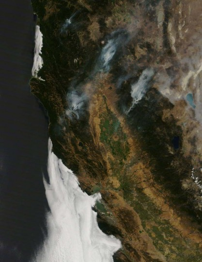 Smoke plumes rise from wildfires in northern California in this NASA handout satellite image. Firefighters made progress in blocking the Ponderosa wildfire from barreling down a rugged canyon toward a community near the Lassen National Volcanic Park, 125 miles north of Sacremento , but the blaze threatened more than 900 homes and buildings. (REUTERS/NASA)