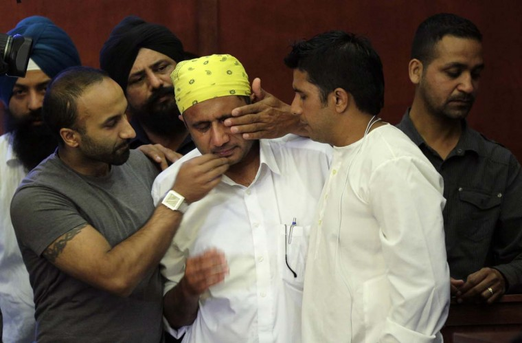 OAK CREEK, MI - AUGUST 6: Mourners cry during a news conference in Oak Creek, Wisconsin, August 6, 2012. The gunman who killed six people at a Sikh temple in southern Wisconsin was a former U.S. serviceman, a law enforcement official said on Monday, and a monitor of extremists said the shooter had links to racist groups. (John Gress/Reuters)