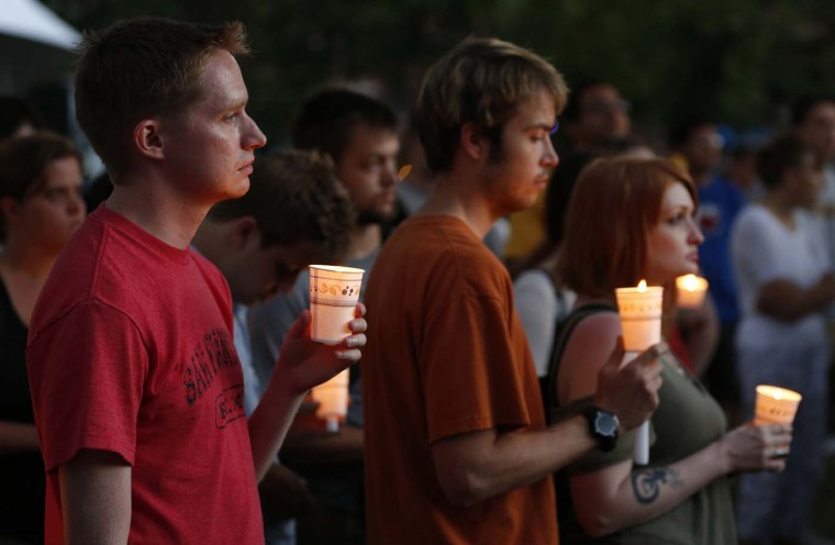 AUGUST 5: People gather at a candle light vigil at Cathedral Square in downtown Milwaukee, Wisconsin August 5, 2012 for those killed at the Sikh Temple of Wisconsin. (Tom Lynn/Reuters)