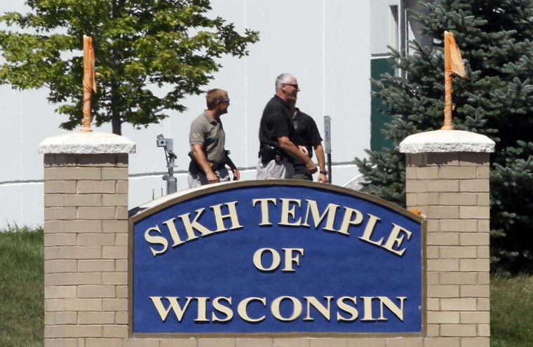 OAK CREEK, WI - AUGUST 5: Officials gather near the Sikh Temple in Oak Creek in Wisconsin August 5, 2012 following a mass shooting inside and outside the Sikh Temple. A shooting during Sunday services at a Sikh temple left at least seven people dead, including a gunman, and at least three critically wounded, police and hospital officials said. (Allen Fredrickson/Reuters)