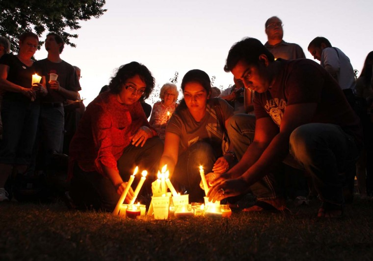 POAK CREEK, WI - AUGUST 5: People light candles during a vigil at Cathedral Square to honor victims of Oak Creek in downtown Milwaukee, Wisconsin August 5, 2012. (Allen Fredrickson/Reuters)