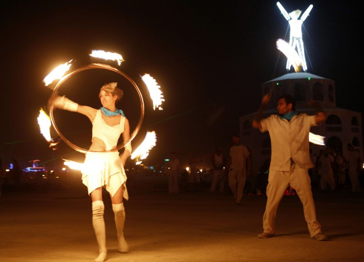 "Members of Pyroklectic perform before the Man burns during the Burning Man 2012 ""Fertility 2.0"" arts and music festival in the Black Rock Desert of Nevada, September 1, 2012. (Jim Urquhart/Reuters)"