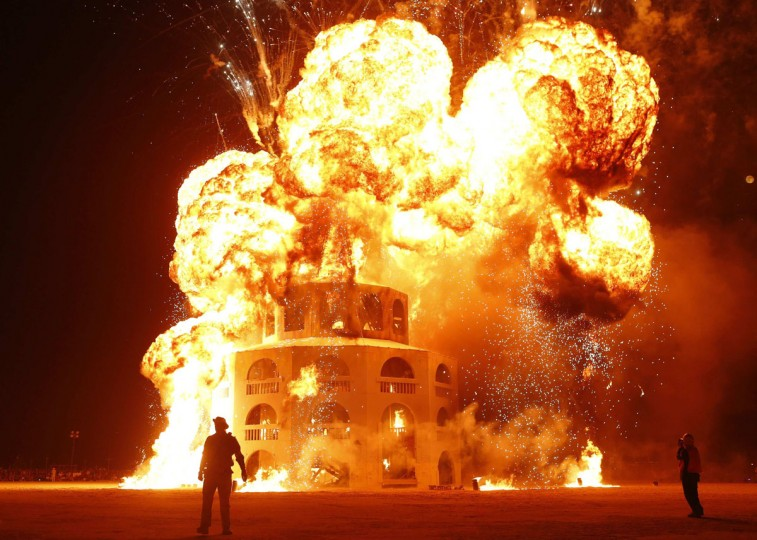 """The Man is engulfed in flames during the Burning Man 2012 """"Fertility 2.0"""" arts and music festival in the Black Rock Desert of Nevada, September 1, 2012. (Jim Urquhart/Reuters)"""