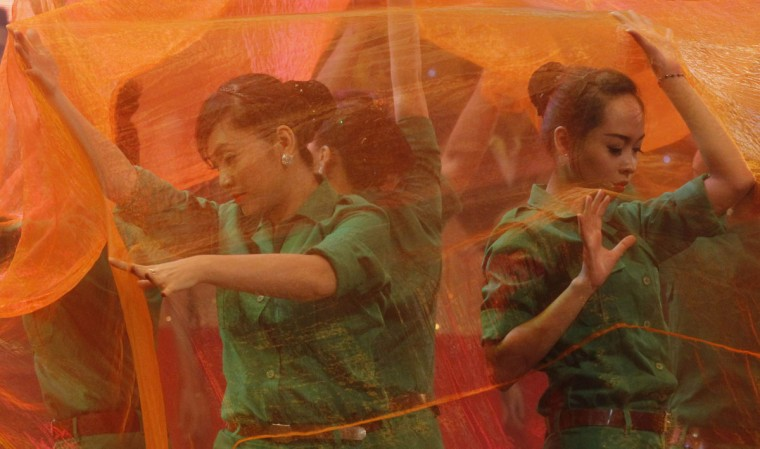 Actresses perform with an orange curtain at a ceremony to mark Agent Orange Day in Hanoi. Agent Orange is a dioxin-laced defoliant sprayed by U.S. troops in the Vietnam War to destroy crops and jungle cover shielding guerrillas. U.S. warplanes used it the first time on August 10, 1961, in Vietnam's central Kontum province, dropping about 18 million gallons of the defoliant on southern Vietnam for most of the 1960s. (Kham/Reuters)