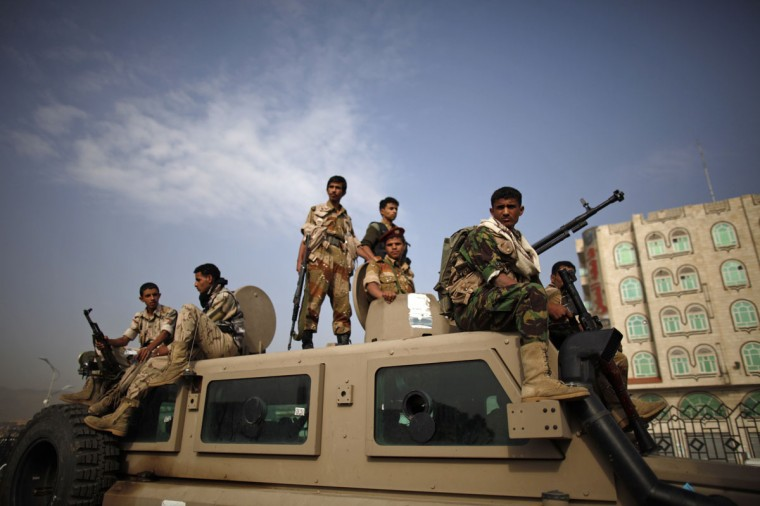 Army soldiers keep watch from atop an armoured personnel carrier patrolling a road, where Eid al-Fitr prayers were held, in Sanaa, August 19, 2012. (Khaled Abdullah/Reuters)