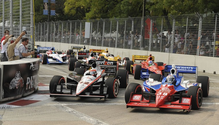 Race cars round a turn at t the start of the Baltimore Grand Prix on Sept. 4, 2011. (Gene Sweeney Jr./Baltimore Sun)