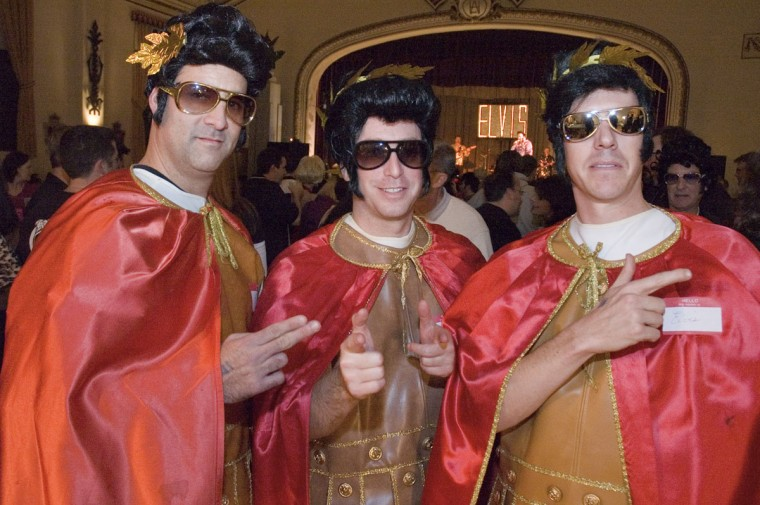 December 2, 2006: (Left to Right) John Levy, David Greenblat, and Jerry Parks dressed at the timeless ruler of rock, Elvis, at the quintessentially Baltimore Night of 100 Elvises. At least 12 bands and 15 Elvis tributes performed. Proceeds from the event go to the Johns Hopkins Children's Center. (Matthew Paul D'Agostino/Baltimore Sun)