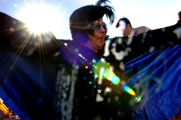 "January 27, 2007: Jonah Baker dressed as Elvis Presley said ""I am wet, I am cold, I am ready for a peanut butter and banana sandwich,"" after dunking into the cold Bay waters. Thousands turned out for the annual Polar Bear Plunge that year. (Monica Lopossay/Baltimore Sun)"