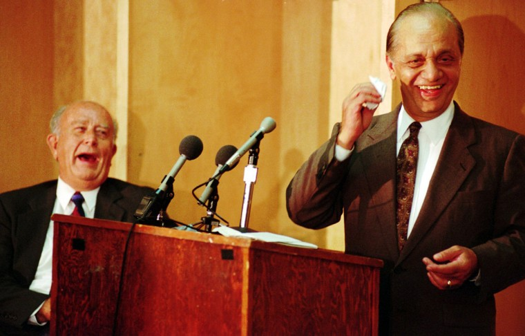 Baltimore attorney Peter Angelos, right, and Gov. William Donald Schaefer share a laugh during a news conference on Aug. 3, 1993 at Camden Yards. Schaefer called the then-record $173 million purchase of the Orioles by Angelos' group