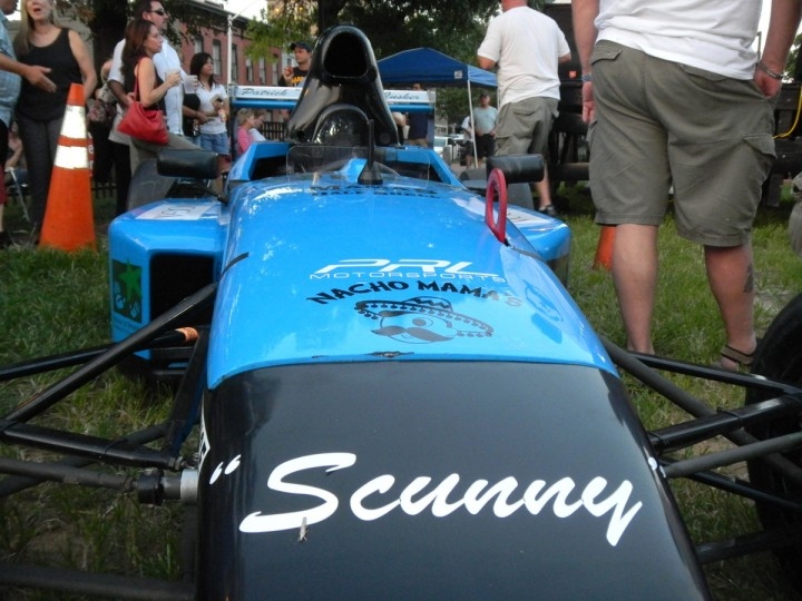 Aug. 30: A number of Federal Hill, Fells Point and Canton businesses came together to pay for the rental and decoration of this USF2000 racing car to participate in the Grand Prix of Baltimore in honor of McCusker. The car and its driver, Canton resident Patryk Tararuj, were both on display in the square for the celebration honoring the late Nacho Mama's and Mama's On The Half Shell owner. (Baltimore Sun)