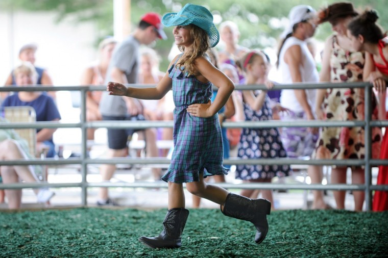 Day 2: Victoria James, 8, of Brookeville shows off her attire during Sunday's 4-H Mini-Fashion Revue. (Brian Krista/Patuxent Homestead)