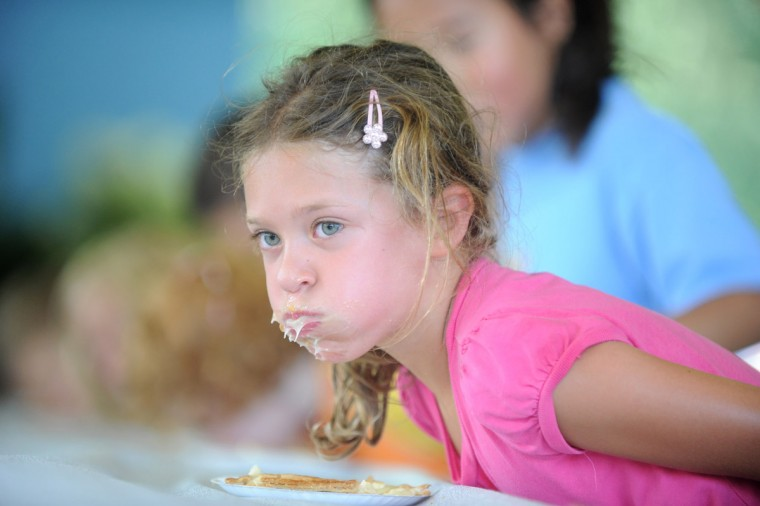 Day 2: Brooke Berlin, 5, of Columbia comes up with apple pie filling on her face during the pie eating contest. (Brian Krista/Patuxent Homestead)