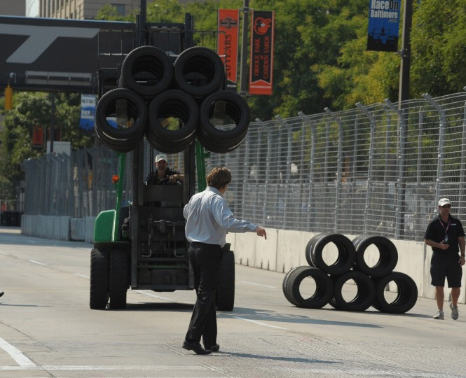 IndyCar official Beaux Barfield directs tires to be dropped on the Grand Prix of Baltimore course for a temporary chicane. The chicane was installed because cars were getting airborne over the railroad tracks on Pratt Street. (Gene Sweeney Jr./Baltimore Sun Photo)