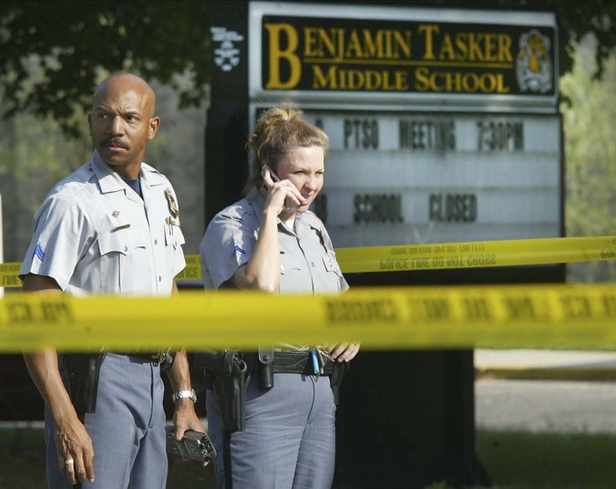 Prince Georges County police officers stand in front of Benjamin Tasker Middle School October 7, 2002 in Bowie, Maryland. A 13-year-old boy was shot and wounded critically outside the school after being dropped off by a relative. Montgomery County Police Chief Charles Moose said that it is too soon to speculate if the shooting of the student is related to five other shootings in the suburbs surrounding Washington, DC. (Mark Wilson/Getty Images)