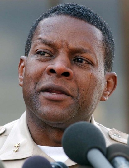 A tearful Montgomery County Police Chief Charles Moose sends a message to parents concerning the shooting of a 13-year-old boy outside a middle school in Bowie, Md., during a news briefing outside police headquarters in Rockville, Md., Monday, Oct. 7, 2002. Police are trying to determine if the shooting is related to a recent spree of sniper attacks in the region. (Gail Burton/AP photo)