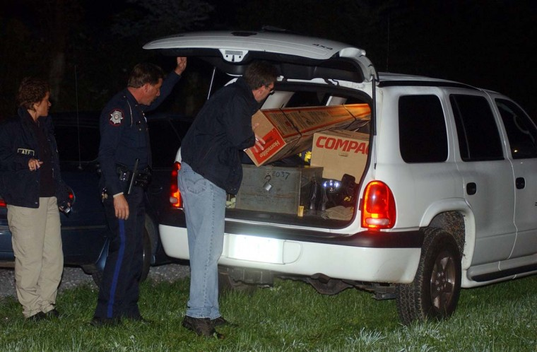 "Unidentiflied police officials removed boxes, possibly containing evidence collected from a house on Elfner Road near the town of Red Lion, Pa. A man who lived in this house is being questioned in connection to the sniper shooting in the Maryland Washington metro area. The officers removed one box, labelled ""Compaq"", right, and a long grass trimmer box from the scene. (Kenneth K. Lam/Baltimore Sun)"