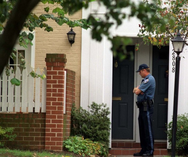 An Arlington Police officer stands watch outside the home of shooting victim Linda Franklin. Franklin, a FBI analyst, is the ninth person killed by the serial sniper operating in the Washington area. (Kim Hairston/Baltimore Sun)