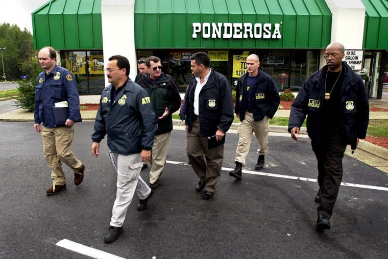 ATF Agents leave the Ponderosa Steak House 20 October 2002 where a 37 year old man was shot late 19 October in Ashland, Va. The shooting, was not fatal and has not been linked to the sniper shootings in the Washington, DC area, but is being investigated as if it were. (Shawn Thew/Getty Images)
