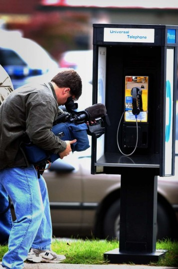 Henrico County, Va., police arrested two possible suspects in connection to the sniper shooting of a 37-year-old man outside a Ponderosa restaurant in Ashland, Va., last Saturday. One man, who drove a white van, was arrested while using a pay phone at the Exxon gas station at the corner of Board street and Parham Road in Richmond, Va. Television camerman takes close-up shot of the pay phone in question. (Kenneth K. Lam/Baltimore Sun)