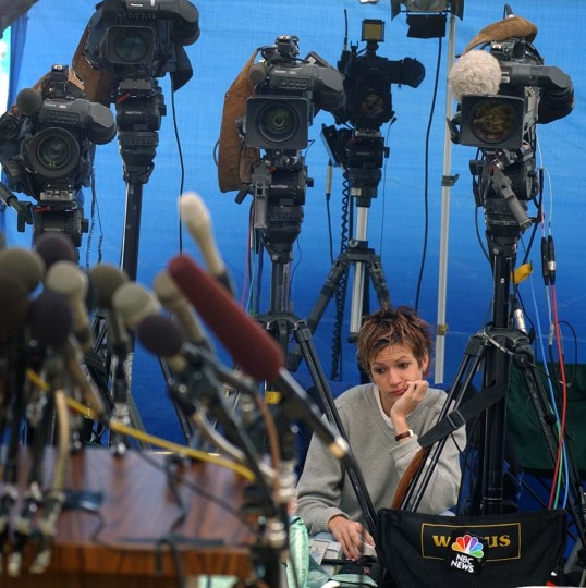 Press conference at at the Montgomery County Police Headquarters regarding the sniper attacks was postponed shortly after 1pm today. Meredith Gunning a videographer for Conus Communications in Washington, D.C. sits behind several video cameras after todays 1pm press conference had been postoned for the second time. (Lloyd Fox/Baltimore Sun)