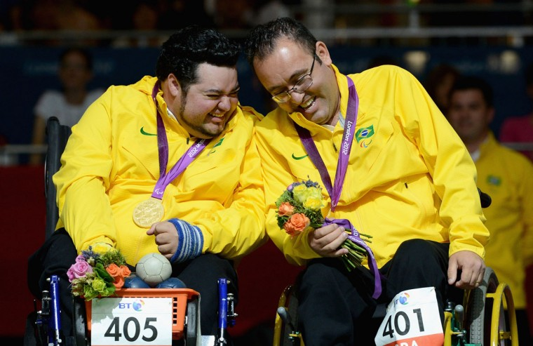 Dirceu Jose Pinto and Eliseu Dos Santos of Brazil celebrate winning gold in Mixed Pairs Boccia - BC4 on day 6 of the London 2012 Paralympic Games at ExCel on September 4, 2012 in London, England. (Gareth Copley/Getty Images)