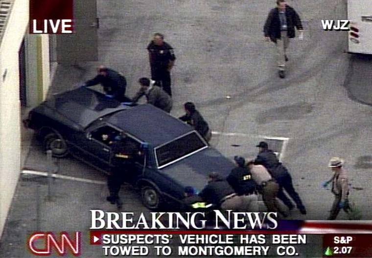 A CNN image shows Maryland police maneuvering the vehicle used by sniper suspects John Allen Williams, also known as John Muhammad, and his stepson John Lee Malvo. The pair, who are suspected in the sniper killing of 10 people in the Washington, DC area, were arrested earlier 24 October at a rest area in Maryland along Interstate 70. (CNN/via Getty images)