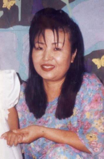 Hong Im Ballenger is shown in a family photo from 1999. Ballistics tests have matched the rifle used in the Washington-area sniper killings with the fatal Sept. 23 shooting of Ballenger, a Baton Rouge, La., beauty shop worker, police said Thursday, Oct. 31, 2002. (TKwang Im Szuszka/The Advocate)