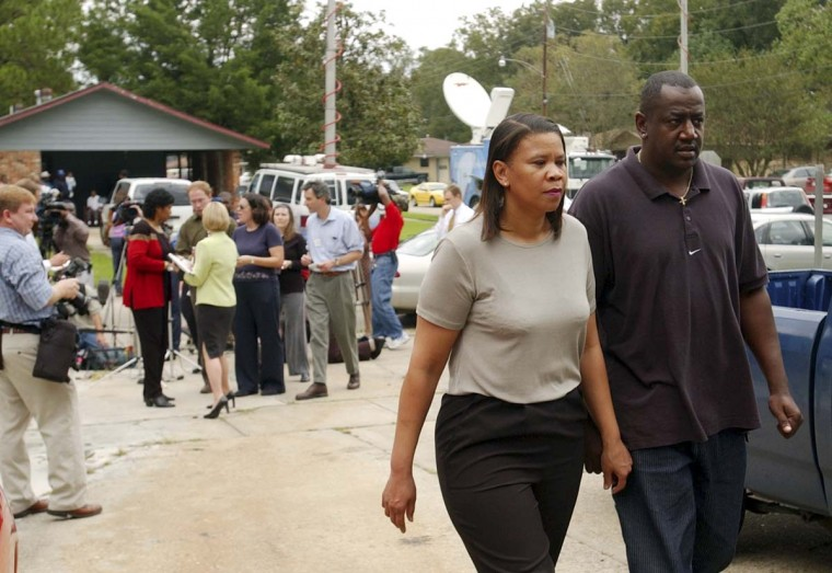 Carol Williams and her friend Vince Hutchinson leave the news conference after her attorney read a statement in front of her home in Baton Rouge, La., Thursday Oct. 24, 2002. Williams is the ex-wife of John Allen Muhammad, who was arrested in connection with the serial sniper case in the Washington area. (Bill Feig/AP photo)
