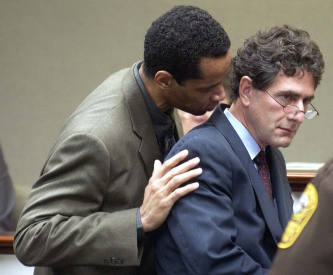 Sniper suspect John Allen Muhammad, left, talks with his attorney Jonathan Shapiro, right, during a bench conference at the Virginia Beach Circuit Court in Virginia Beach, Va., Monday Nov. 3, 2003. (Dave Ellis/AP Photo)