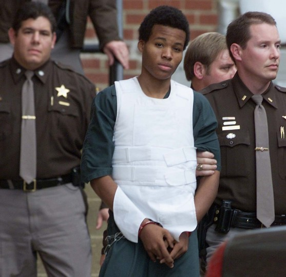 Washington area sniper suspect John Lee Malvo is escorted by Fairfax County Sheriffs out of Fairfax County juvenile court in Fairfax, Virginia, November 15, 2002. Malvo was at a hearing to decide whether he is to be prosecuted as an adult or a minor in the recent Washington area sniper shootings that took place last month. (Brendan McDermid/Reuters photo)