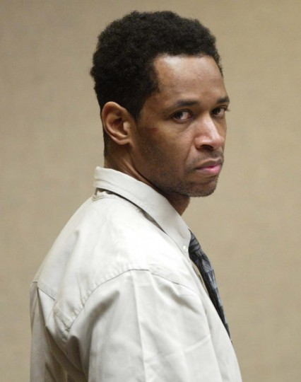Convicted sniper John Allen Muhammad looks around the courtroom at the beginning of his trial in Virginia Beach, Va., in this Oct. 14, 2003 file photo. (Lawrence Jackson/AP photo)