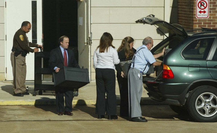 Defense attorney Peter Greenspun loads files into the back of his vehicle after after the jury failed to agree on the death penalty or prison for convicted sniper John Allen Muhammad at the Virginia Beach Circuit Court November 21, 2003 in Virginia Beach, Virginia. Deliberations will continue on November 24. (Jeff Caplan/Getty Images)