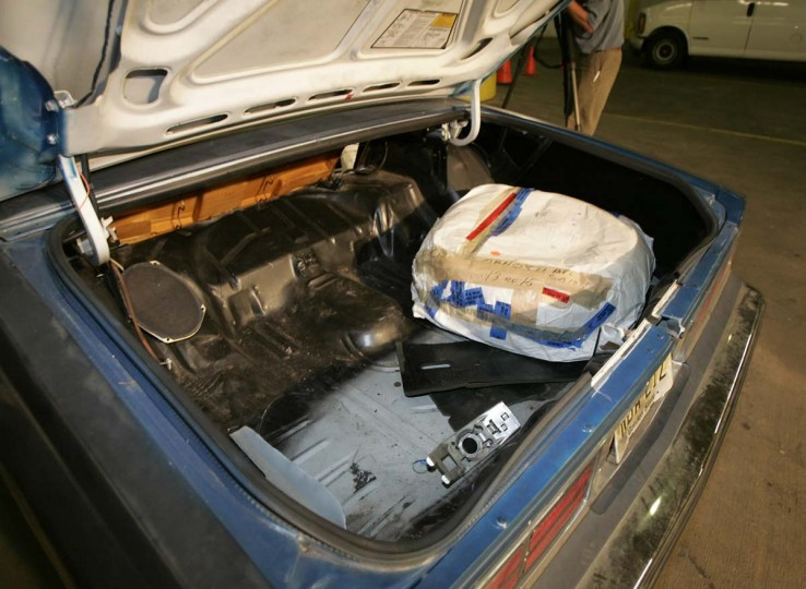 The trunk of the 1990 Caprice used by convicted sniper John Allen Muhammad and Lee Boyd Malvo is seen at the Montgomery County Judicial Center after it was entered into evidence in the murder trial of Muhammad Wednesday, May 17, 2006, in Rockville, Md. There was a hole cut in the back of the trunk and the rifle was shot out of the hole. Muhammad, who is representing himself is on trial on six murder charges for killings in Maryland during the Oct 2002 Washington area sniper spree.(Chris Gardner/AP photo)