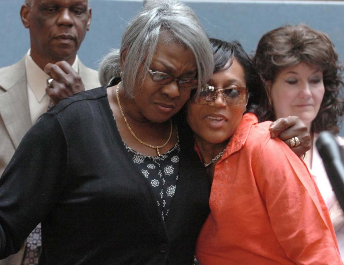 Sonia Wills and Denise Johnson, mother and wife of sniper victim Conrad Johnson, hug in the lobby of the Montgomery County Judicial Center after speaking about the sentencing of convicted sniper John Allen Muhammad. (Kim Hairston/Baltimore Sun)