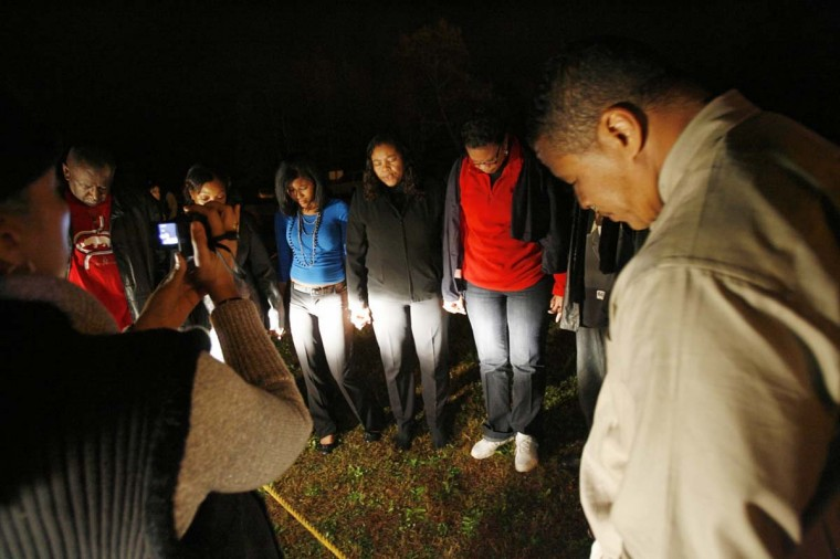 Family members of convicted sniper John Allen Muhammad pray outside Greenville Correctional Center in Jarratt, Va., at the scheduled time of Muhammad's execution on Nov. 10, 2009. Muhammad was executed for sniper attacks that killed 10 people in Virginia, Maryland and Washington, D.C. during a 3-week spree in 2002. (Dean Hoffmeyer/AP photo)