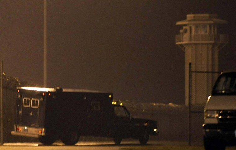 A vehicle carrying the body of executed sniper John Allen Muhammad departs the Greensville Correctional Center in Jarratt, Virginia, November 10, 2009. Muhammad was sentenced to die for the murder of Dean Harold Meyers, one of 10 people left dead in a shooting spree by Muhammad and younger accomplice Lee Boyd Malvo that terrorized the Washington, DC, area in October 2002. (REUTERS/Jonathan Ernst)