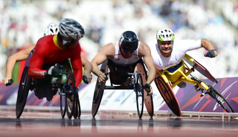 Venezuala's Jesus Aguilar (R) crashes just before the finish line of the men's 800m T53 round 1 heat 2 during the athletics competition at the London 2012 Paralympic Games in the Olympic Stadium in east London on September 4, 2012. (Leon Neal/AFP/Getty Images)