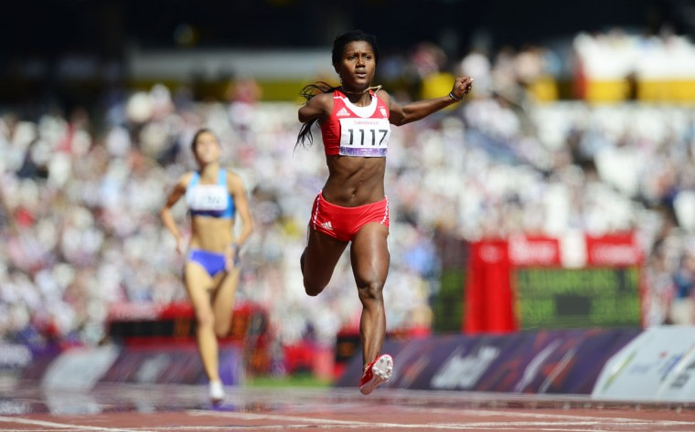 Cuba's Yunidis Castillo celebrates wins the women's 100m T46 round 1 heat 2 during the athletics competition at the London 2012 Paralympic Games in the Olympic Stadium in east London on September 4, 2012. (Leon Neal/AFP/Getty Images)