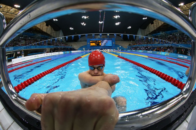 Thomas Young of Great Britain competes in the Men's 100m Backstroke - S8 heat 1 on day 6 of the London 2012 Paralympic Games at Aquatics Centre on September 4, 2012 in London, England. (Photo by Clive Rose/Getty Images)